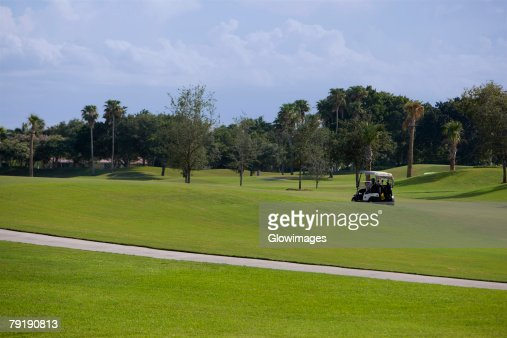 Golf cart in a golf course : Foto de stock