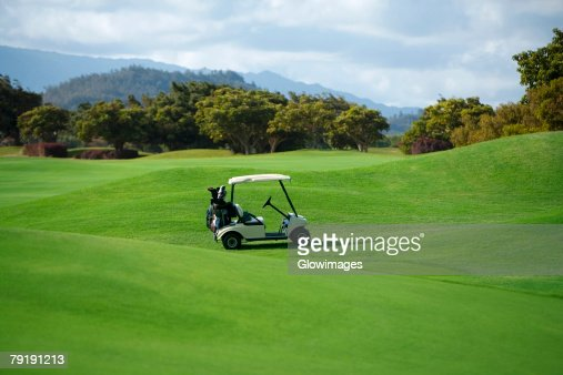 Golf cart in a golf course : Stock Photo