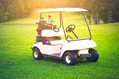 Golf cart on golf course is beautiful fairway and layout