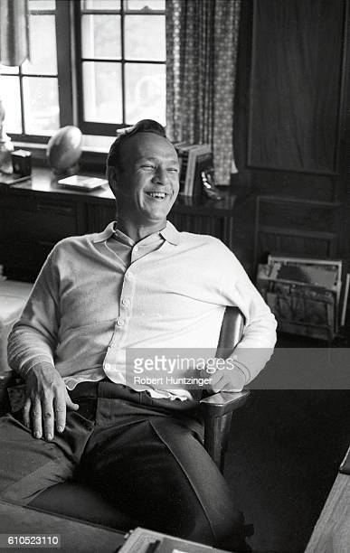 Casual portrait of Arnold Palmer seated during photo shoot at home Latrobe PA CREDIT Robert Huntzinger