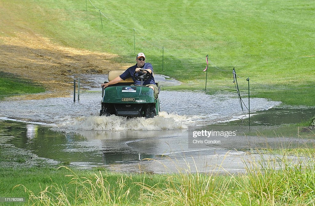 A Golf Channel Golf cart plows through a puddle at the 15th hole after a storm bringing heavy rains flooded several areas of the golf course during the second round of the Constellation SENIOR PLAYERS Championship at Fox Chapel Golf Club on June 28, 2013 in Pittsburgh, Pennsylvania.