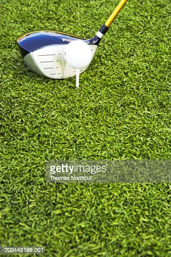 Golf club, golf ball and tee on artificial turf : Stock Photo