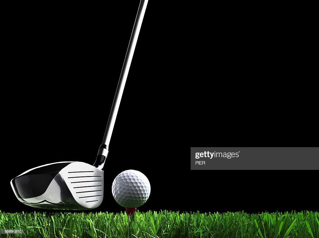 Golf club teeing up to hit ball : Stock Photo