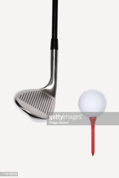 Golf club with golf ball on a tee