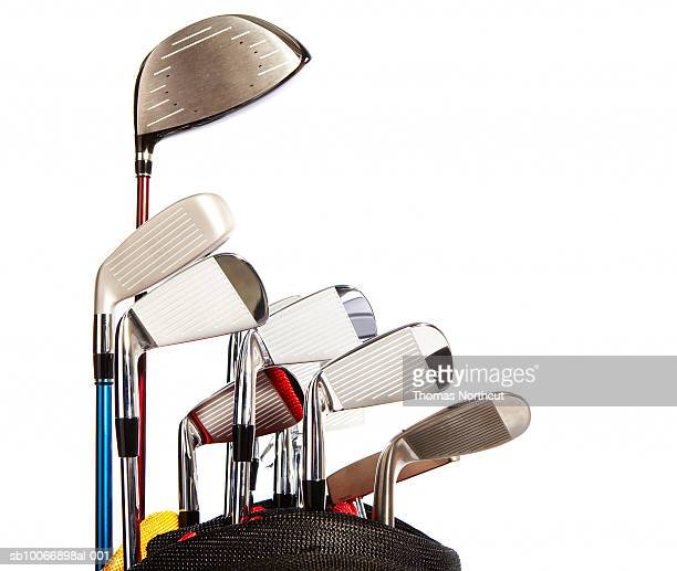 Golf clubs against white background