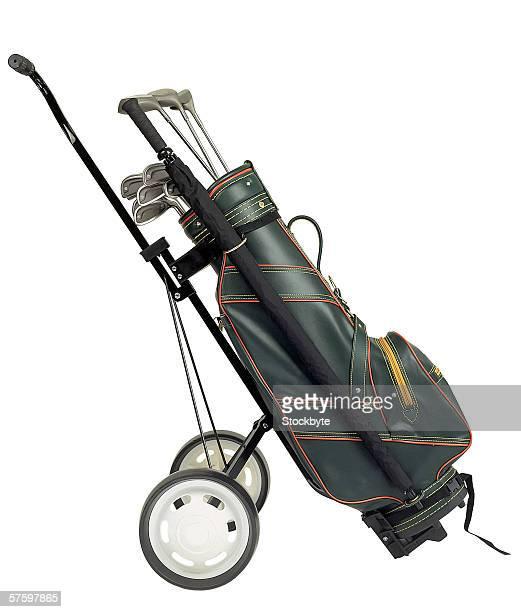 golf clubs in a golf bag on a trolley