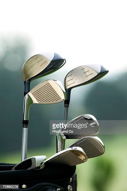 Golf clubs in bag at golf course, close-up