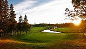 A golf course fairway with a water hazard.