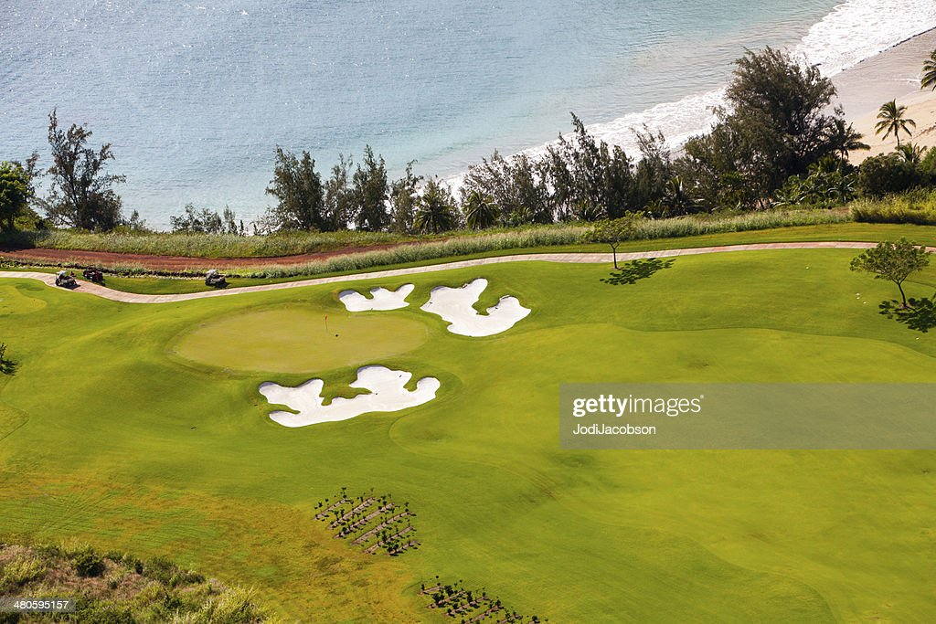 Golf course overlooking the Pacific Ocean in Kauai, Hawaii : Stock Photo