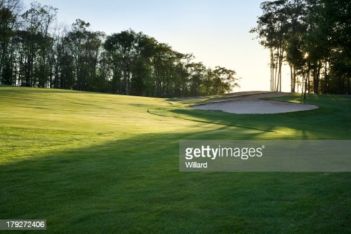 Golf fairway in late afternoon sun : Stock Photo