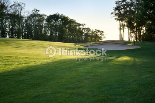 Golf fairway in late afternoon sun : Stock Photo