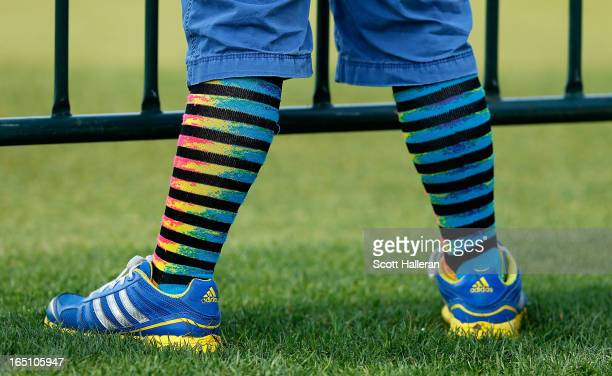 A golf fan is seen during crazy sock day in the third round of the Shell Houston Open at the Redstone Golf Club on March 30 2013 in Humble Texas