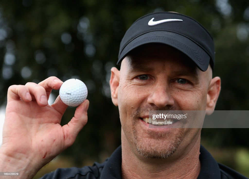 Golf fan Kurt Stelzer poses with the golf ball of Tiger Woods of the USA, which he climbed a palm tree to retrieve during the third round of the WGC - Cadillac Championship at the Trump Doral Golf Resort & Spa on March 9, 2013 in Doral, Florida.