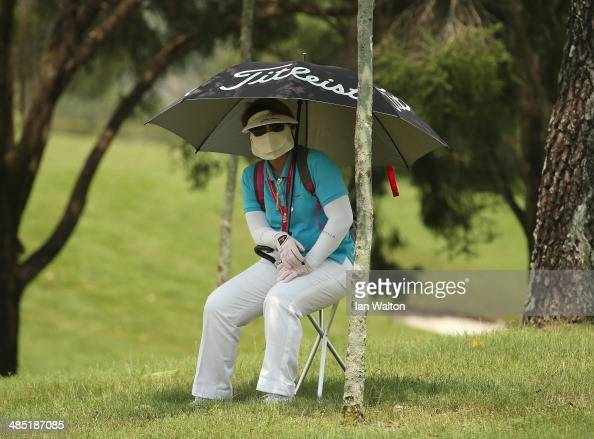 A golf Fan looks on during round one of the 2014 Maybank Malaysian Open at Kuala Lumpur Golf Country Club on April 17 2014 in Kuala Lumpur Malaysia