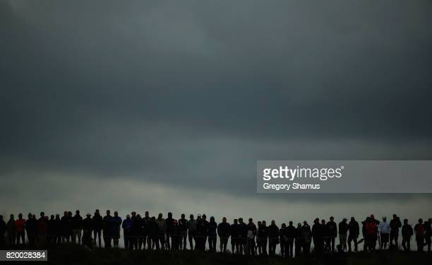 Golf fans gather under dark clouds during the second round of the 146th Open Championship at Royal Birkdale on July 21 2017 in Southport England