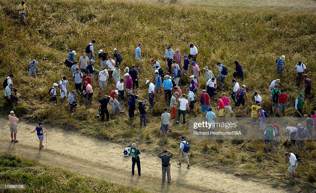 Golf fans help <a gi-track='captionPersonalityLinkClicked' href=/galleries/search?phrase=Luke+Donald&family=editorial&specificpeople=194977 ng-click='$event.stopPropagation()'>Luke Donald</a> of England look for his ball during the first round of the 142nd Open Championship at Muirfield on July 18, 2013 in Gullane, Scotland.