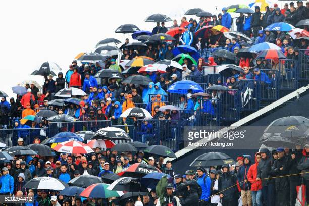Golf fans watch the action from a grandstand on the 17th hole during the second round of the 146th Open Championship at Royal Birkdale on July 21...