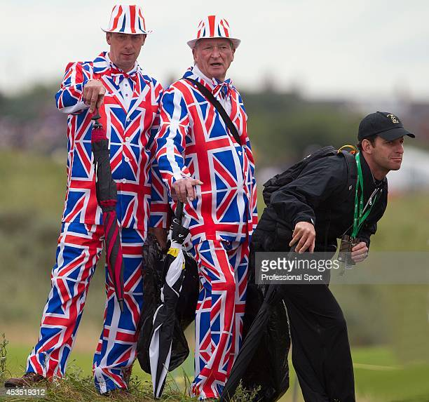 Golf fans wearing Union Jack clothing enjoy the atmosphere during the first round of the 141st Open Championship at Royal Lytham St Annes Golf Club...