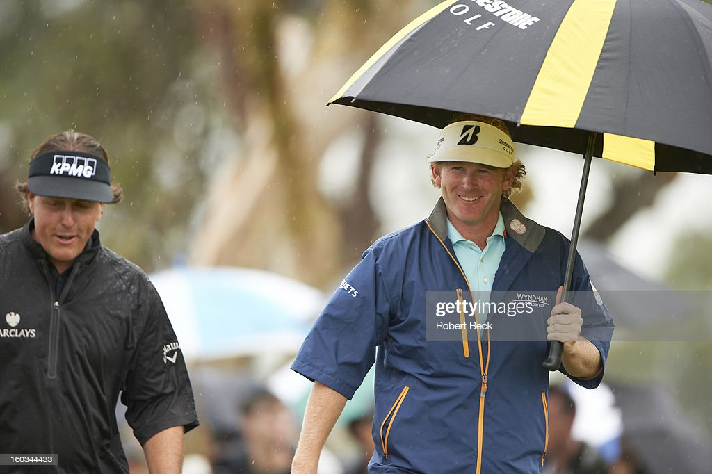 Brandt Snedeker and Phil Mickelson walking during rain delay on Friday at Torrey Pines GC. Robert Beck F394 )