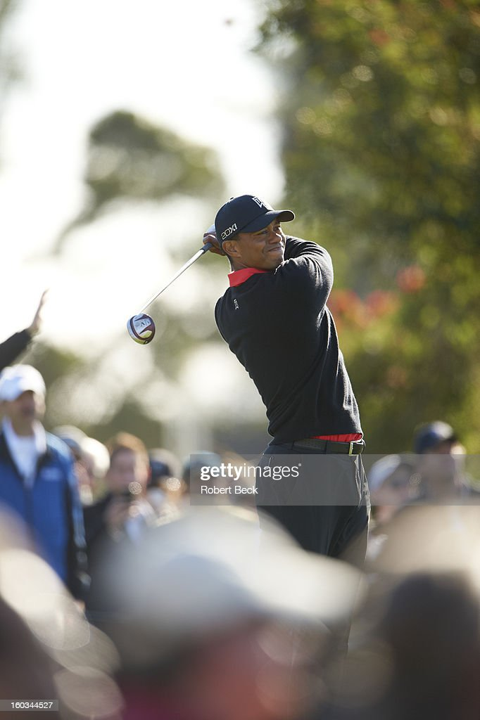 Tiger Woods in action, drive during Monday play at Torrey Pines GC. Robert Beck F77 )