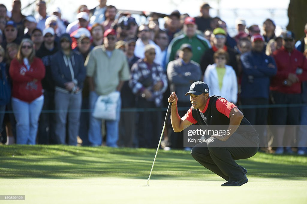 Tiger Woods lining up putt during Monday play at Torrey Pines. Kohjiro Kinno F27 )