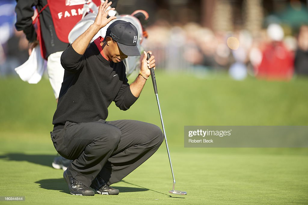 Tiger Woods victorious, on No 18 green during Monday play at Torrey Pines GC. Robert Beck F59 )