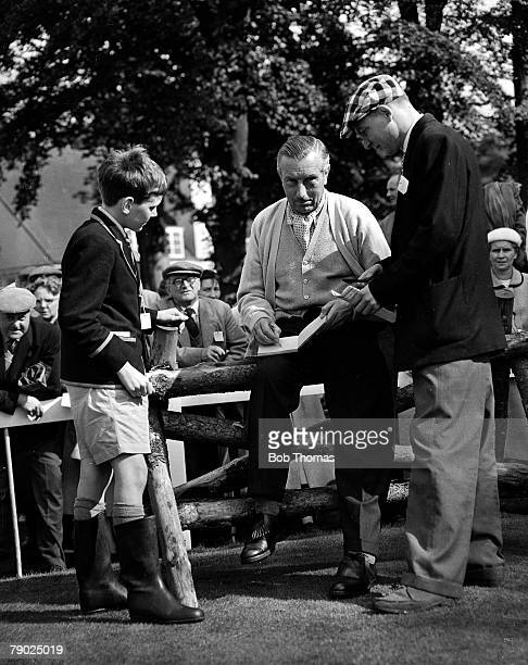 Golf Great Britain's Henry Cotton signing autographs at the Dunlop Masters at Little Aston Henry Cotton was a three times winner of the British Open...
