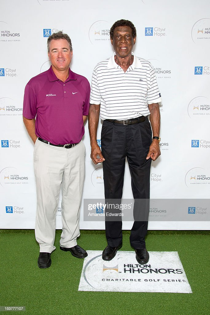 Golf instructor Brian Mogg (L) and former NBA player Elgin Baylor arrive at the 6th Annual Hilton HHonors Charitable Golf Series at The Riviera Country Club on October 8, 2012 in Pacific Palisades, California.