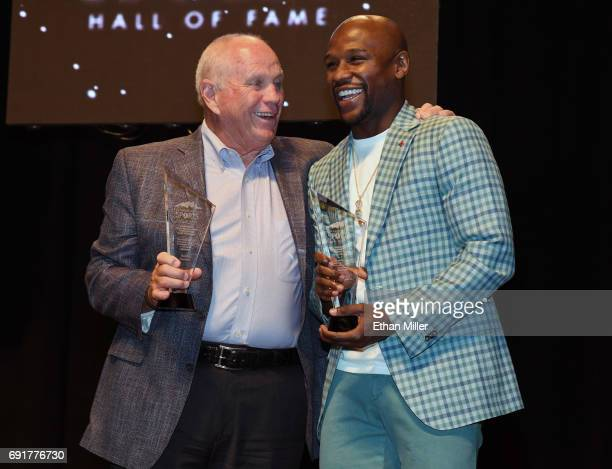 Golf instructor Butch Harmon and boxer Floyd Mayweather Jr pose after they were both inducted into the Southern Nevada Sports Hall of Fame at the...