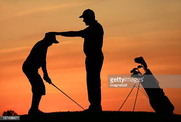 Golf Instructor With Student on the Driving Range