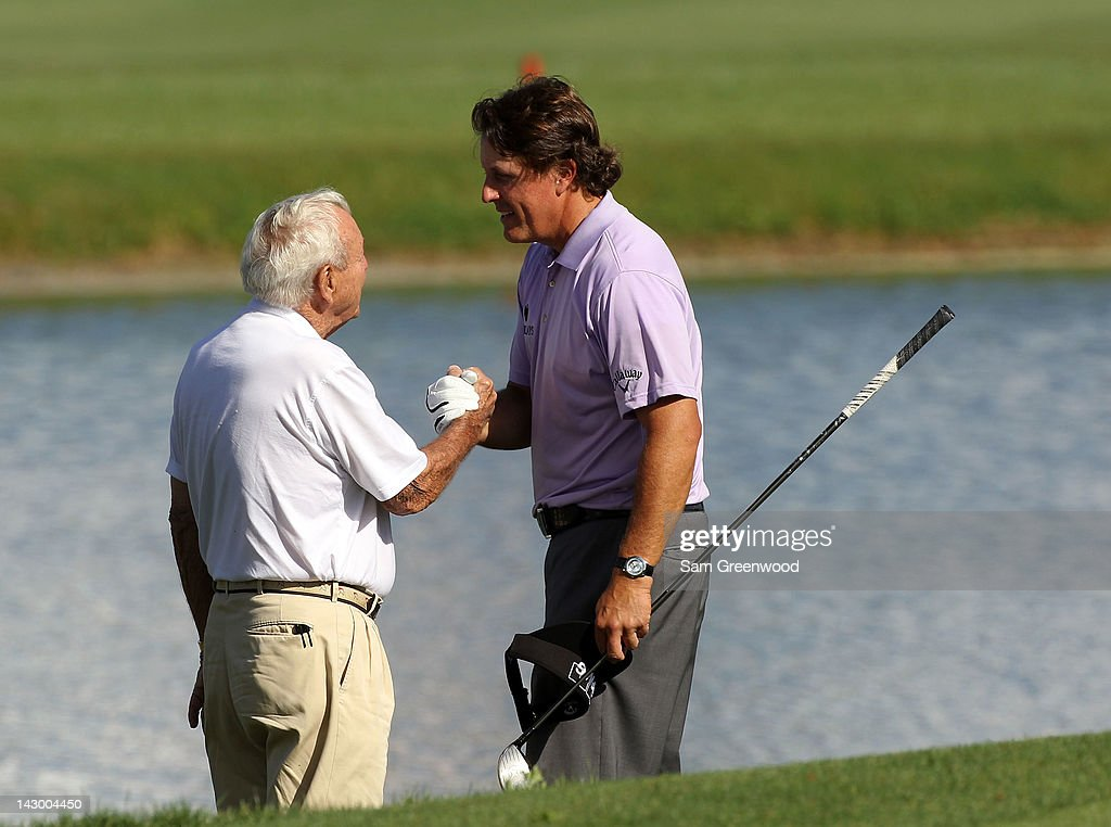 Golf legend Arnold Palmer (L) shakes hands with Phil Mickelson during the first round of the Arnold Palmer Invitational presented by MasterCard at the Bay Hill Club and Lodge on March 22, 2012 in Orlando, Florida.