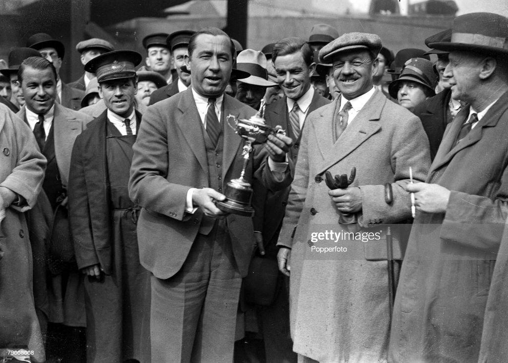 Golf London England 16th April American golfer Walter Hagen handing back the Ryder Cup trophy to Mr J Batley of the Professional Golfers Association...
