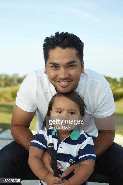 Masters Preview Portrait of Jason Day with son Dash during photo shoot at The Concession GC Bradenton FL CREDIT Ben Van Hook