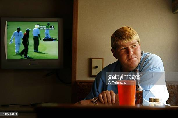 Golf Masters Week Closeup portrait of John Daly with beer in RV motor coach trailer outside Hooters Restaurant View of tournament on TV Augusta GA...