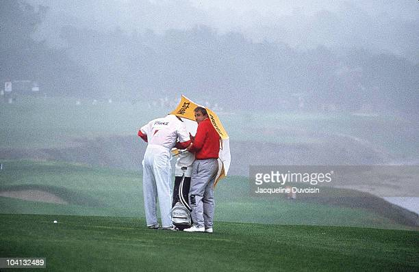 Nabisco Championship Curtis Strange with caddie under umbrella during Sunday play at Pebble Beach Golf Links Pebble Beach CA CREDIT Jacqueline...