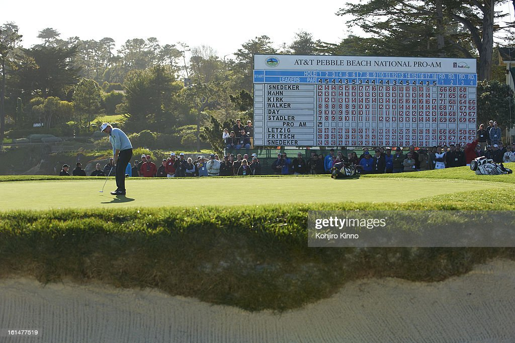 Brandt Snedeker in action, putt during Sunday play at Pebble Beach Golf Links. View of leaderboard. Kohjiro Kinno F57 )