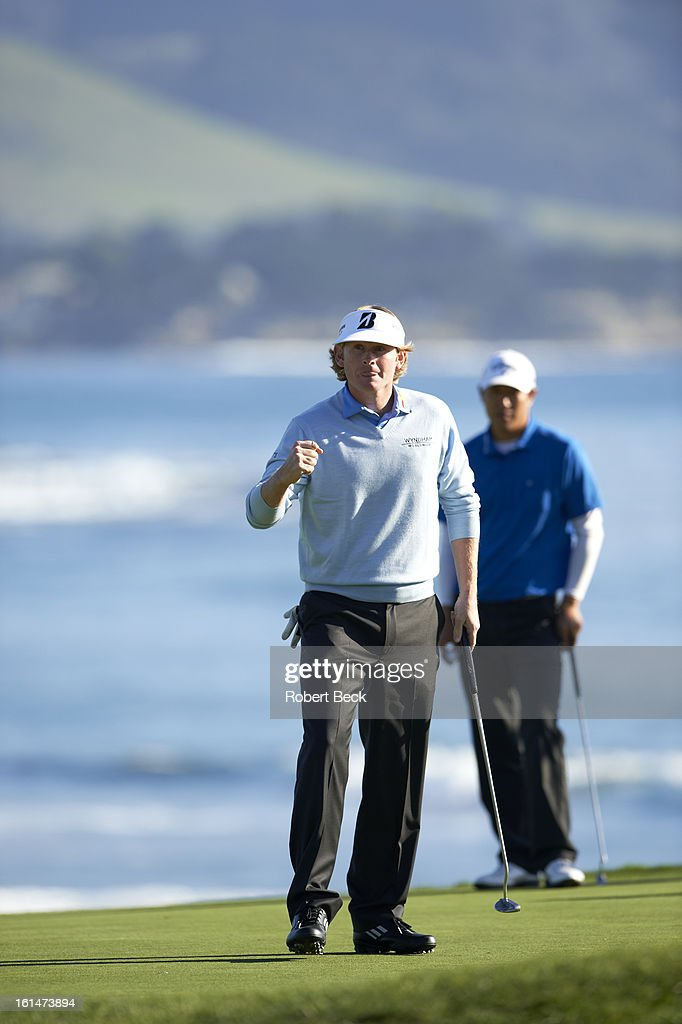 Brandt Snedeker victorious on No 18 green after winning tournament on Sunday at Pebble Beach Golf Links. Robert Beck F211 )