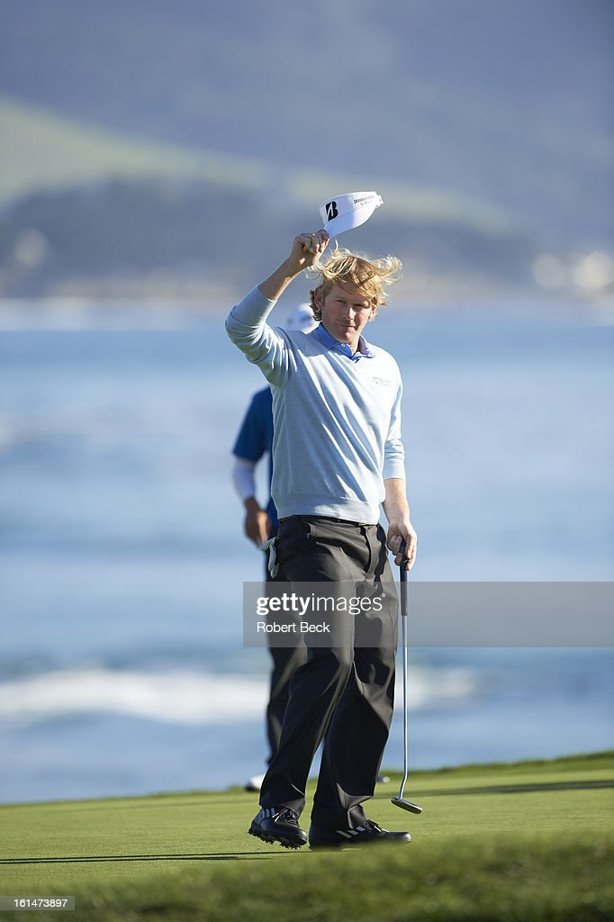 Brandt Snedeker victorious on No 18 green after winning tournament on Sunday at Pebble Beach Golf Links. Robert Beck F219 )