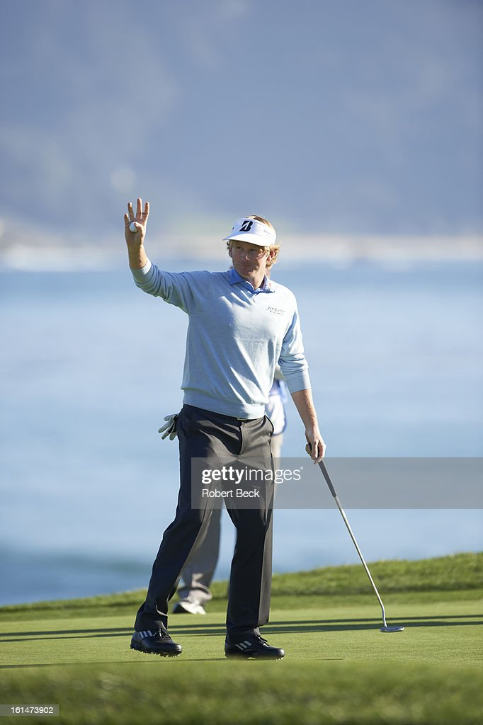 Brandt Snedeker victorious on No 18 green after winning tournament on Sunday at Pebble Beach Golf Links. Robert Beck F228 )