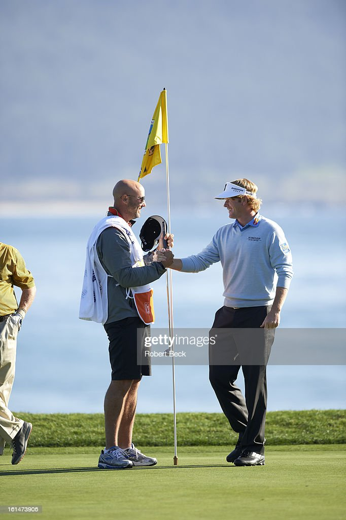 Brandt Snedeker victorious on No 18 green after winning tournament on Sunday at Pebble Beach Golf Links. Robert Beck F252 )