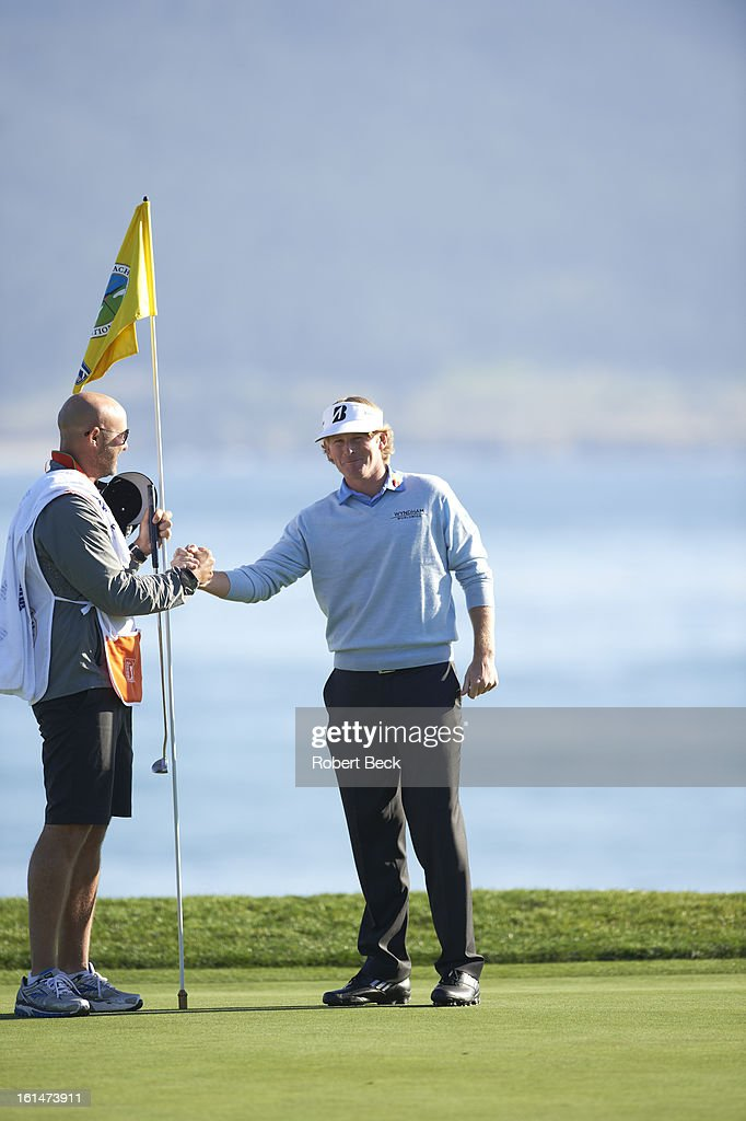 Brandt Snedeker victorious on No 18 green after winning tournament on Sunday at Pebble Beach Golf Links. Robert Beck F256 )