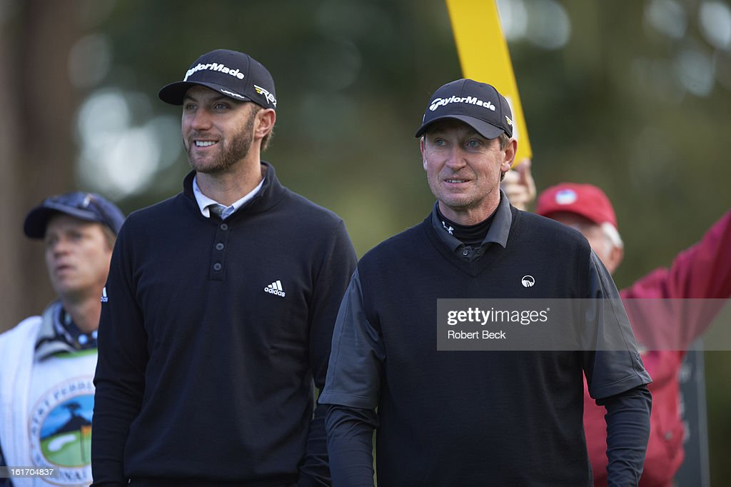 Dustin Johnson (L) with former hockey player and NHL Hall of Famer Wayne Gretzky during Friday play at Pebble Beach Golf Links. Robert Beck F113 )