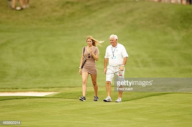 PGA Championship Gerry McIlroy father of Rory McIlroy walks with Gala Alten girlfriend of Pablo Larrazabal during Tuesday practice round at Valhalla...
