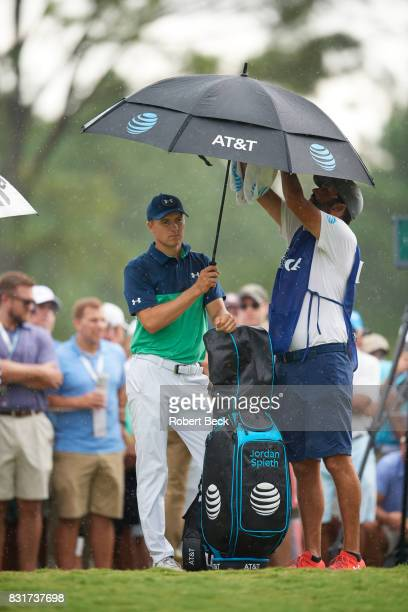 PGA Championship Jordan Spieth holding umbrella during rain during Friday play at Quail Hollow Club Charlotte NC CREDIT Robert Beck