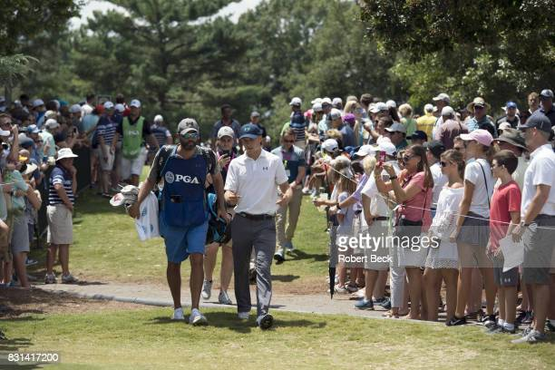 PGA Championship Jordan Spieth walking with caddie Michael Greller on fairway during Saturday play at Quail Hollow Club Charlotte NC CREDIT Robert...