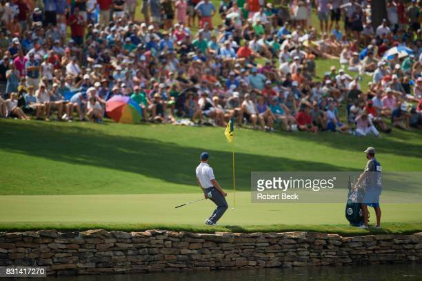 PGA Championship Rear view of Jordan Spieth in action putting during Saturday play at Quail Hollow Club Charlotte NC CREDIT Robert Beck