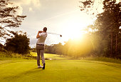 Man playing golf at golf course