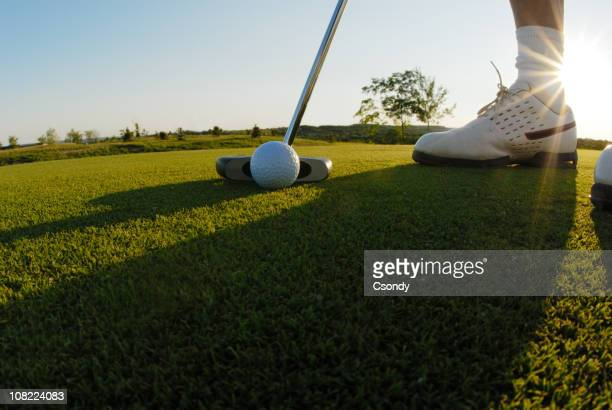Golf player close up in sunset