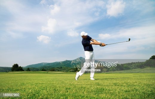 Golf Player. Perfect Swing on the Course. Moody Sky.