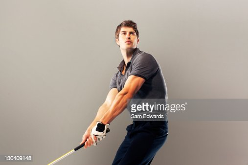 Golf player ready to swing club : Stock Photo